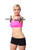 Eignungsmädchen mit Dummkopf. glückliche blonde anhebende Gewichte der jungen Frau, lokalisiert Lizenzfreies Stockbild