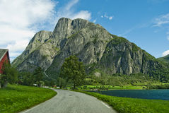 Eikesdalen lake and mountain. Scenic view of Eikesdalen village with road by Eikesdalsvatnet lake and mountains in background, Norway Stock Photo