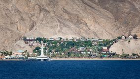 Eilat Aquarium Observatory. Port of Eilat, Israel marine observatory and aquarium with resort and landscape background royalty free stock photos