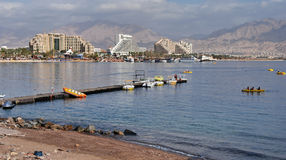 Eilat city harbor. Scenic view of Eilat city harbor with beach in foreground, Gulf of Eilat, Israel Royalty Free Stock Photography