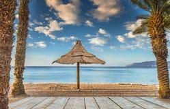 Morning on sandy beach in Eilat,  Israel Royalty Free Stock Photos