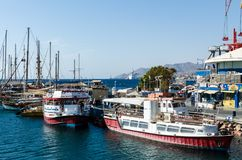 EILAT, ISRAEL – November 7, 2017: Marina with docked yachts and boats. EILAT, ISRAEL – November 7, 2017: Sunny morning at marina in Eilat with royalty free stock photo