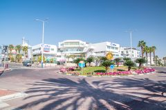 Rotary international roundabout with buildings in background in Eilat town stock images