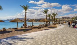 Eilat, Israel- January 15, 2018: Central promenade in Eilat, Israel. Serene day at central promenade and public beach in Eilat-famous resort city in Israel Royalty Free Stock Images