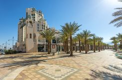 Eilat, Israel - March 17, 2018: Central promenade, Eilat. Central promenade with surrounding hotels, shopping places and palm trees Royalty Free Stock Photo