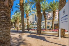 Eilat, Israel - March 17, 2018: Morning at central promenade in Eilat, Israel. Central public promenade with hotels, restaurants, coffee shops and palm trees Royalty Free Stock Photos