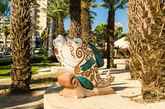 Colorful sculpture of fish painted with floral patterns in in beige and green tones, Eilat, Israel Stock Photos