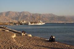 Eilat, Israele - sera sulla spiaggia Fotografia Stock Libera da Diritti