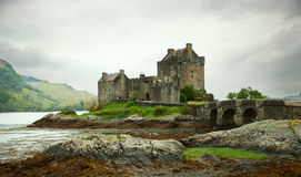 Eilean Donan castle. On a cloudy day. low tide. Scotland. UK Royalty Free Stock Photography