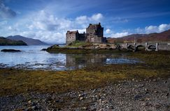 Eilean Donan Castle. Eilean Donan (Scottish Gaelic: Eilean Donnáin) is a small island in Loch Duich in the western Highlands of Scotland. It is connected to the Royalty Free Stock Photography