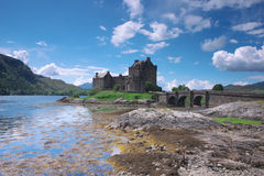Eilean Donan Castle. In Scotland lays at the meeting point of three sea lochs Duich, Alsh and Long and is one of Great Britains most emblematic visitor stock photography