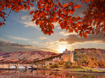 Eilean Donan Castle against autumn leaves in Highlands of Scotland Stock Photography
