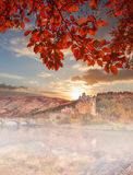 Eilean Donan Castle against autumn leaves in Highlands of Scotland Royalty Free Stock Images