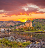Eilean Donan Castle against sunset in Highlands of Scotland Stock Photo