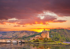 Eilean Donan Castle against sunset in Highlands of Scotland Royalty Free Stock Image
