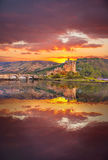 Eilean Donan Castle against sunset in Highlands of Scotland Royalty Free Stock Photography