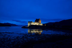Eilean Donan Castle, Loch Duich, Scotland. At late evening showing lit castle against blue sky Royalty Free Stock Photography