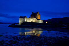 Eilean Donan Castle, Loch Duich, Scotland. At late evening showing lit castle against blue sky Royalty Free Stock Image
