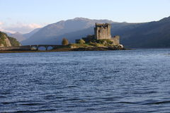 Eilean Donan Castle. Looking south at Eilean Donan castle and footbridge with Sgurr Mhic Bharraich in the background Stock Photography