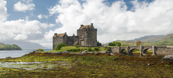 Eilean Donan castle, Scotland. Eilean Donan castle in a sunny day, Scotland Highlands during a shallows period of Loch Duich. You can see the bridge without Royalty Free Stock Photos