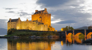 Eilean Donan castle, Scotland. Highlands. This picture has been take during the night with great reflex in the water of Loch Duitch Royalty Free Stock Images