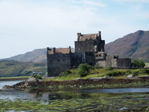 Eilean Donan castle in Scotland. Celtic medieval scottish stone building on island at lake loch Duich in Highlands in Great Britain with cloudy sky in 2016 Royalty Free Stock Images