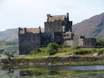 Eilean Donan castle in Scotland. Celtic medieval scottish stone building on island at lake loch Duich in Highlands in Great Britain with cloudy sky in 2016 Royalty Free Stock Photos