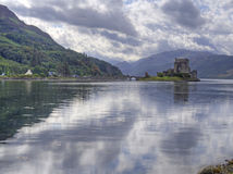 Eilean donan castle scotland with reflection. Eilean donan castle in scotland with reflection Royalty Free Stock Images