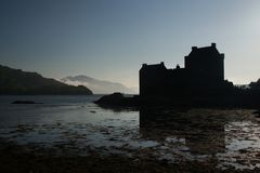 Eilean Donan Castle silhouette. Mysterious Scottish Eilean Donan Castle silhouette in Kyle of Lochalsh Royalty Free Stock Photography