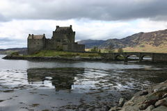 Eilean Donan Castle. Still waters reflect the iconic Scottish castle Royalty Free Stock Photography
