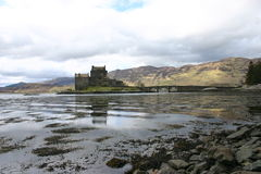 Eilean Donan Castle. Still waters reflect the iconic Scottish castle Royalty Free Stock Photo