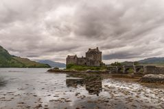 Eilean Donan Castle under rainy cloudscape, Scotland. Stock Photography