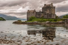 Eilean Donan Castle under rainy cloudscape, Scotland. Stock Photos