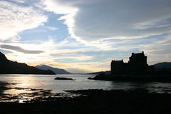 Eilean Donan Silhouette. As the sun sets behind the Cuillins of Skye, one of Scotlands most iconic buildings becomes just a silouette Stock Photos