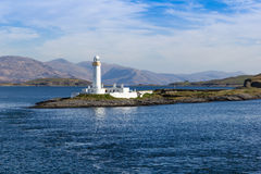 Eilean Musdile Lighthouse. Eilean Musdile, or Mansedale, is an islet, and lighthouse to the south west of Lismore in the Inner Hebrides Stock Image