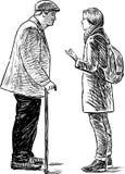 Ein älterer Mann und ein junges Mädchen sprechen Stockbilder