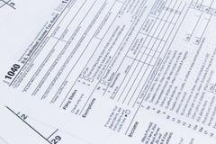 Ein Abschluss oben eines 1040 Steuerformulars US-Individualeinkommen-Steuererklärungsform Lizenzfreies Stockfoto