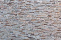Ein abstrakter Hintergrund der bunten Steinwandbeschaffenheit Stockfotos