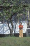 Ein African-Americanmädchen, das eine Amerika-Markierungsfahne anhält Lizenzfreie Stockbilder