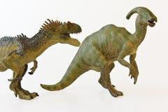 Ein Allosaur bedroht ein Parasaurolophus Lizenzfreies Stockfoto