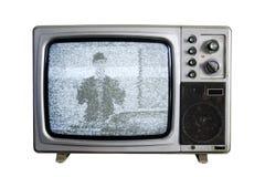 Ein alter Fernsehapparat mit den Geräuschen auf weißem Hintergrund Lizenzfreie Stockfotos
