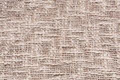Ein alter hellbrauner Segeltuchbeschaffenheitshintergrund Lizenzfreie Stockbilder