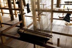 Ein alter spinnender Webstuhl und ein Thread des Garns Lizenzfreies Stockbild