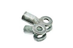 Ein altes Eisen-Quadrat-Schlüssel-Schlüssel-Werkzeug-Lügen Stockbilder
