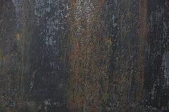 Ein altes, rostiges Blatt des Metalls mit einer gedämpften blauen Farbe Der Hintergrund für Ihr Design Stockfotografie