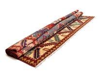 Ein anderer gerollter persischer Teppich Lizenzfreie Stockbilder