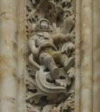Ein Astronaut auf der Fassade der Kathedrale Lizenzfreie Stockfotos
