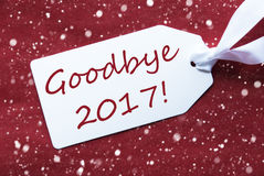 Ein Aufkleber auf rotem Hintergrund, Schneeflocken, Text Auf Wiedersehen 2017 Stockfotografie