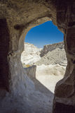 Ein Avdat Canyon caves. The valley of the Ein Avdat park in the Negev Desert in Israel is framed through an opening to one of the caves in the canyon walls Stock Photography