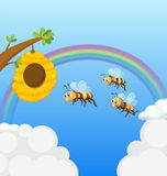 Ein Bienenstock und die drei Bienen Lizenzfreies Stockfoto